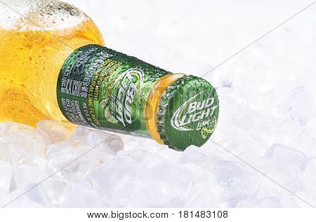 IRVINE CA - APRIL 13 2017: Bud Light Lime Bottle on Ice. From Anheuser-Busch InBev Bud Light Lime is a flavored beer introduced in 2008.