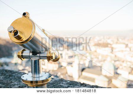 Binoculars on a viewing platform in Salzburg, Austria. The concept of leisure, vacation