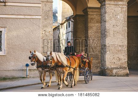 Austria, Salzburg, January 01, 2017: the Horse. Entertainment of tourists (horseback riding) in the Austrian city of Salzburg - hometown of Mozart. Vacation, holidays, attractions.