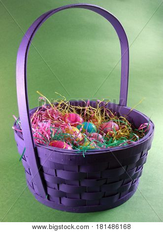 Easter basket filled with artificial and colorful plastic eggs ready for the holiday