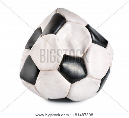 Deflated soccer ball isolated on white background.