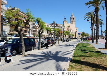 SITGES SPAIN - MAY 23: The tourists enjoiying their vacation at seafront on May 23 2015 in Sitges Spain. Up to 60 mln tourists is expected to visit Spain in year 2015.