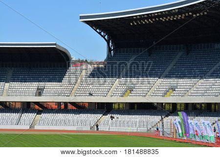 CLUJ-NAPOCA ROMANIA - APRIL 9 2017: Cluj Arena stadium tribunes detail. The modern stadium was officially opened on October 1 2011 the building is ranked as an UEFA Elite Stadium.