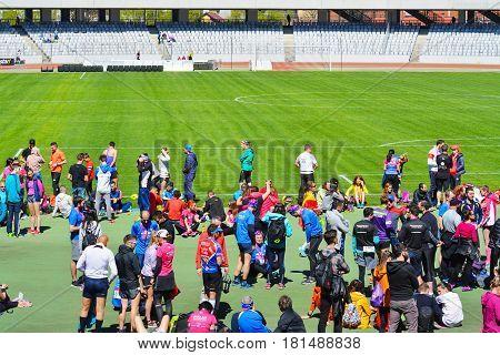 CLUJ-NAPOCA ROMANIA - APRIL 9 2017: Marathon runner athletes wait for the award ceremony in Cluj Arena stadium at the Wizz Air Cluj-Napoca Marathon.