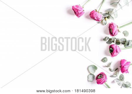 Modern spring design with bright pink flowers on white desk background top view moke up