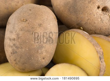 A large group of objects raw potatoes