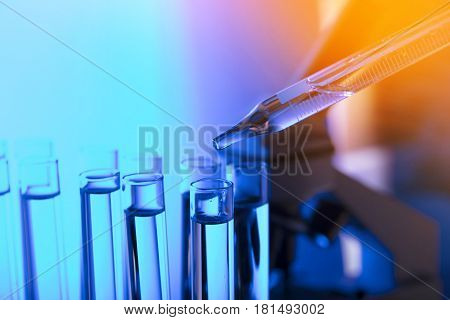 Laboratory theme.  Laboratory experiment. Test tubes. Scietific lab concept. Blue background.