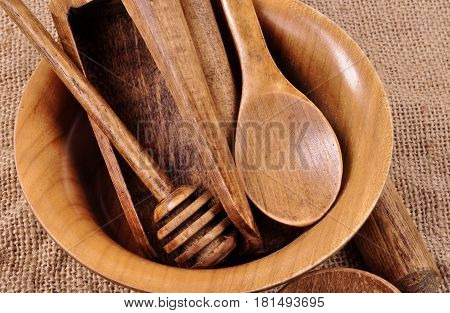 Kitchen house wooden belongings. A plate, a spoon,