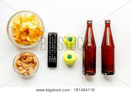 snacks for watching sport match with balls and beer on white deskbackground top view mock-up