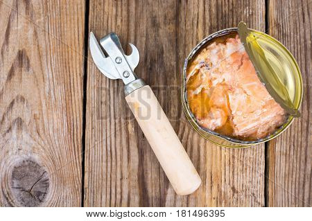 Canned fish salmon or tuna in open metal can. Studio Photo