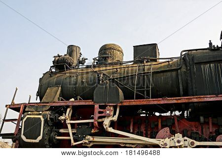 A part of a retro steam locomotive of black color