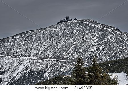 Snow-covered mountain and shelter in the Giant Mountains Poland