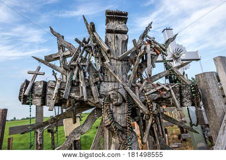 Close up on croos on pilgrimage site called Hill of Crosses Lithuania