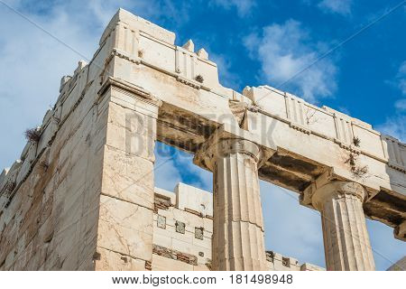 Columns of ancient Propylaea gate on Acraopolis hill in Athens Greece