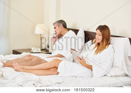 Couple ordering food from room service in a hotel room