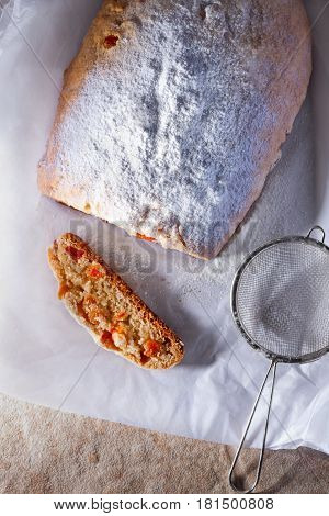 Slice of Traditional Christmas Stollen on a table