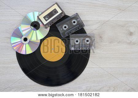 Retro, vinyl record disc, audio cassette and cd close up image