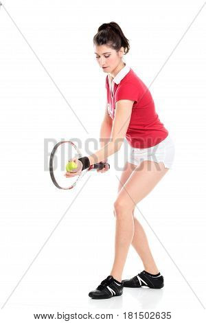 Full lenght isolated studio picture from a young woman with tennis racket