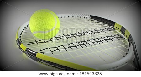 Tennis ball on a racket close up image .