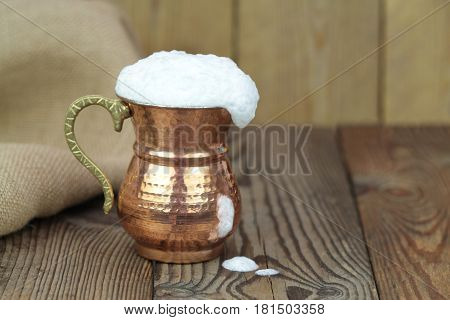 Ayran - Traditional Turkish yoghurt drink in a copper metal cup close up image