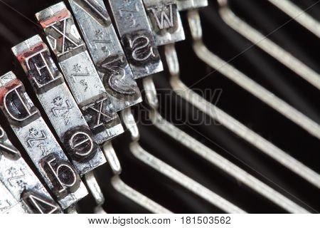 Typewriter type bars , macro shot .