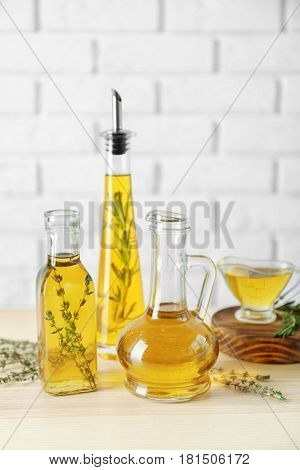 Olive oil with spices on table in light room