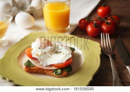 Tasty egg Benedict on plate