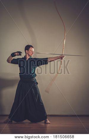Man practicing Kyudo bow shooting.
