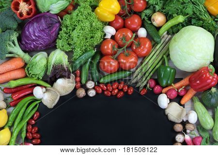 Fresh colorful vegetables with black text space close up image