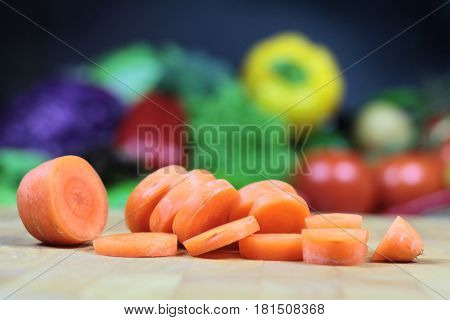 Chopped carrot on a chopping board close up image