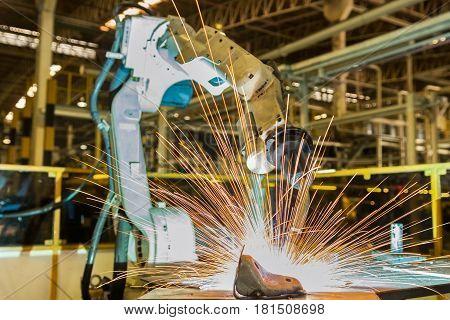 Robot is welding part in automotive industrial