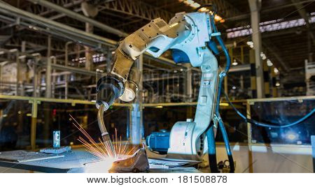 Robot is welding part in automotive industrial