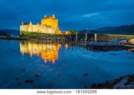 Stunning Sunset Over Lake At Eilean Donan Castle In Scotland