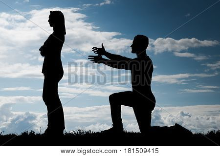 Silhouette Of A Man Trying To Convince Her Girlfriend