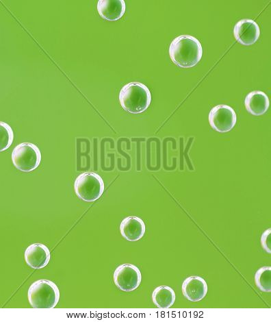 Soda bubbles in the bottle close up image