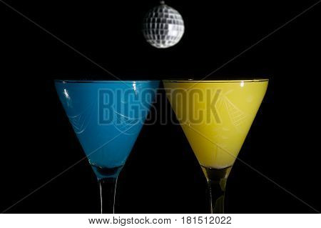 two drinks on a party night on black background