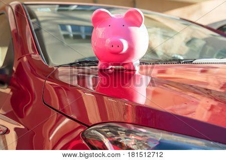 Close-up Of A Piggybank On New Car