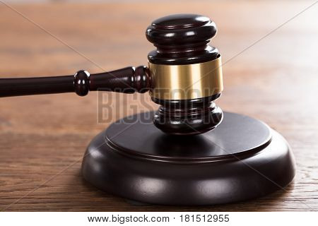 Close-up Of A Gavel Striking On Wooden Desk In A Courtroom