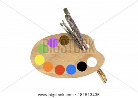 Paint brushes, colors and artist palette on white background