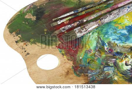 Paint brushes and artist palette close up image