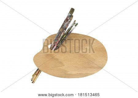 Paint brushes and artist palette on white background