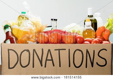 Donation Box Full Of Groceries On Table