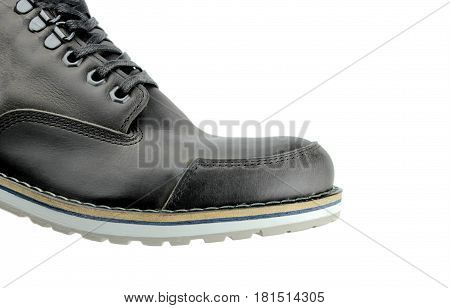 Black man boot on white background. Macro image
