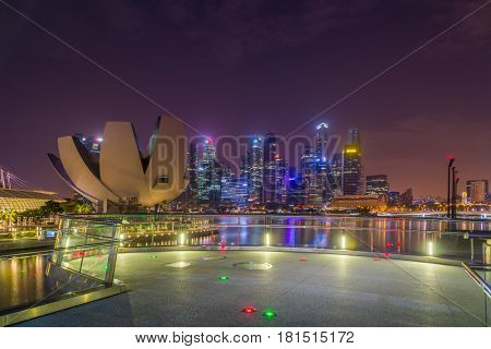 SINGAPORE CITY, SINGAPORE - FEBRUARY 16, 2017: The Helix Bridge is a pedestrian bridge linking Marina Centre with Marina South in the Marina Bay area in Singapore.