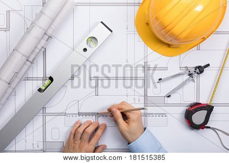 High Angle View Of Architect Hands Working On Blueprint