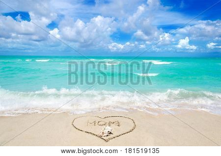 Mother's day background on the sandy beach near ocean Miami beach Florida
