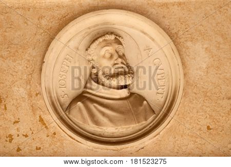 ROME, ITALY - SEPTEMBER 03: Saint Joseph of Cupertino, bass relief in portico of church dei Santi XII Apostoli in Rome, Italy on September 03, 2016.