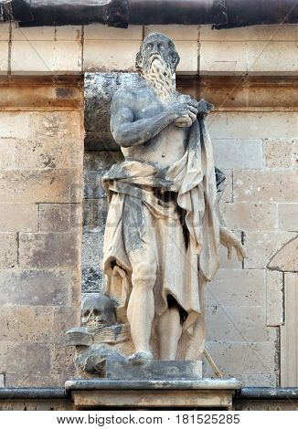 DUBROVNIK, CROATIA - NOVEMBER 07: Statue of Saint Jerome on the Cathedral of Assumption of the Virgin Mary in the Old Town of Dubrovnik, Croatia on November 07, 2016.