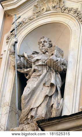 ROME, ITALY - SEPTEMBER 05: Statue of Saint John of Matha on facade of Santissima Trinita degli Spagnoli Church in Rome, Italy on September 05, 2016.