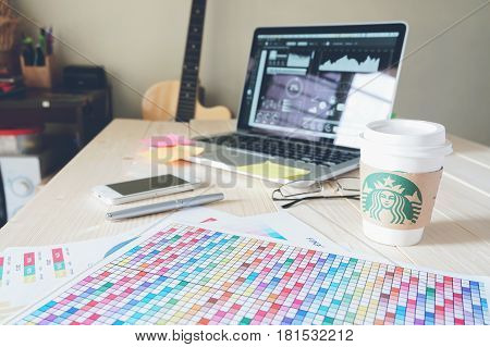 BANGKOK THAILAND - April 14 2017 : Cup of Starbucks coffee with new logo on wood background
